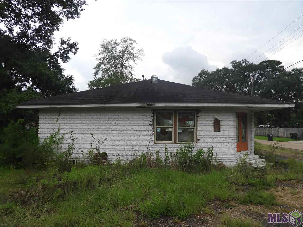 HAVE IT YOUR WAY!! This one need to be completed. Restoration started but not complete. Spacious three bedroom two bath, large family room. Corner lot larger than most in the area. Completely fenced. Double garage and carport. Can be used for parking on parting with the family.