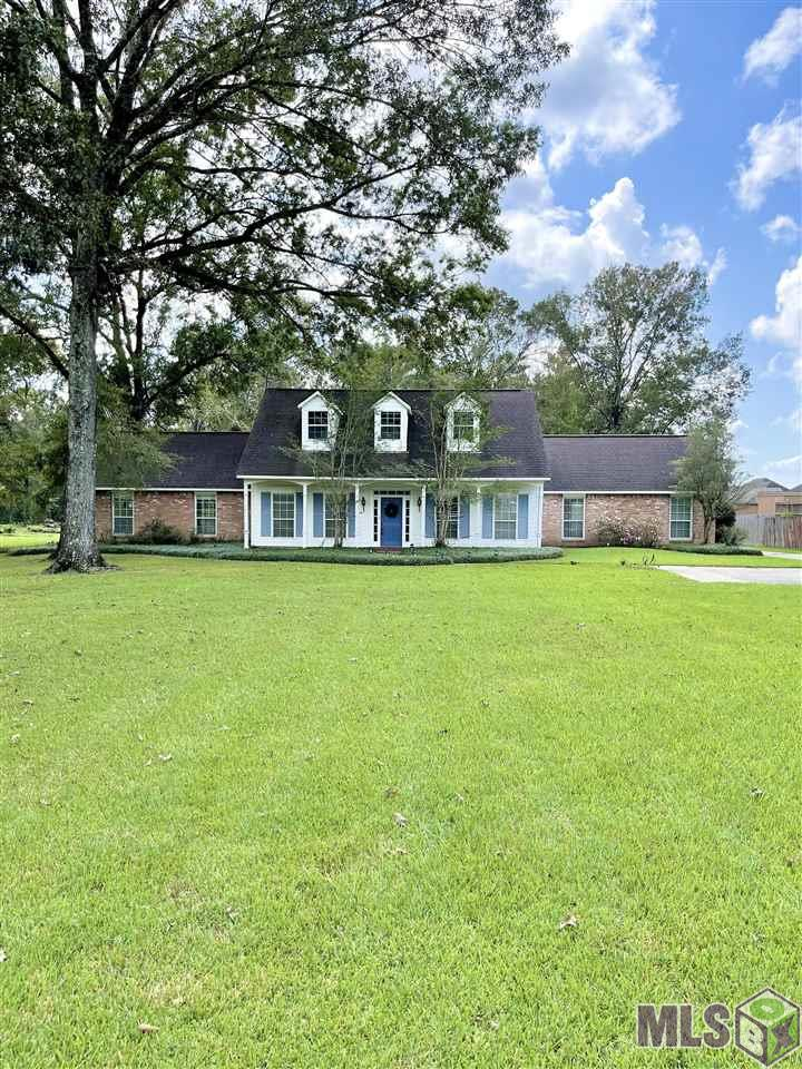 Located on a secluded dead end street makes for the perfect family home! With over an acre of land, mature trees, an extra long driveway with extra parking in the front and a double carport in the back this home is perfect for entertaining! The living room is large with a wood burning fireplace, built ins, crown molding and full of light from the french doors that open up to the back porch overlooking the beautiful view of large trees and the private wooded area to the back! All bedrooms are huge with walk in closets. As an added bonus there is a detached Mother In Law Suite of 660 sqft with a private bathroom, counter space and french doors opening to the large concrete patio! The possibilities are endless with this little peace of heaven!! Property did not flood and in the great school district of Central community!! Schedule your showing today before this one is gone!!