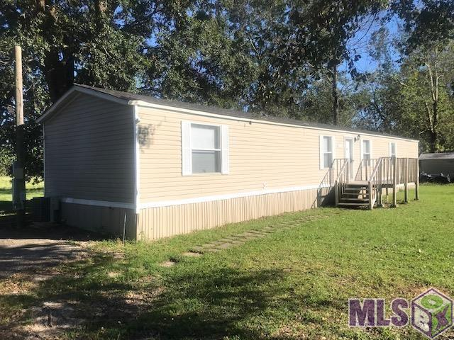 Nice 16 x 80 mobile home on almost a 1/2 acre.  Home has been freshly painted with neutral colors.   Wood laminate flooring in living room and halls with vinyl in kitchen and wet areas.  Kitchen has an abundance of counter and cabinet space.  Enjoy fall evenings from the back or front deck in this fantastic rural setting.  Dead end street with no thru traffic.  No flood zone.
