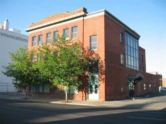 "Elevator up to your Penthouse Loft in Downtown Spokane.    Expose brick walls, 9'7"" ceilings, stainless appliances.   Huge private storage room in lower level.  Comes with one car park in heated garage. Quality finishes including hardwood floors, granite counters, stainless appliances, ceramic tile showers and floors, gas fireplace in living room."