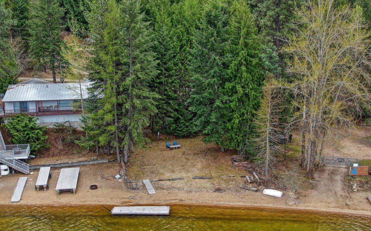 65 feet of rare waterfront property on Deer Lake with sunny, sandy beach & gorgeous cedar trees! Not many of these left.  Water, Sewer and Power are all stubbed ON lot and operational. No giant climb down to the water on this lot... gentle slope. 2 access points. Association has a boat launch and road is maintained for year round access. Don't miss this waterfront piece of property just waiting for your new Lake Home!!