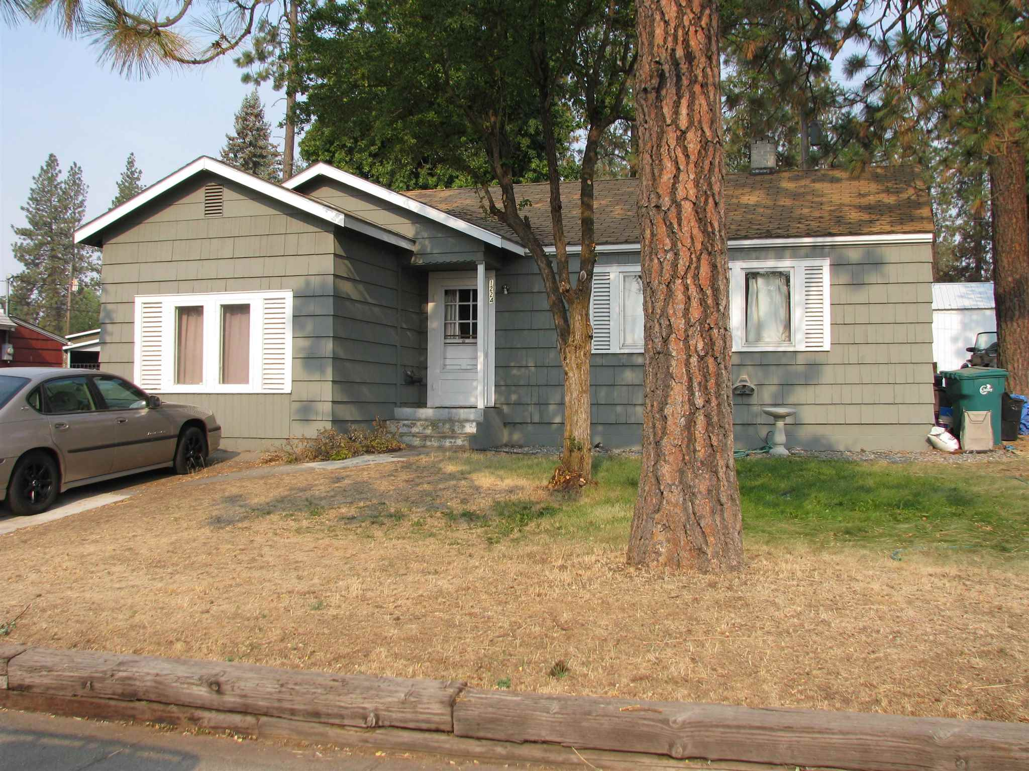 Great investment opportunity! Three-bedroom, one bath house on a double-sized lot close to Eastern Washington University. Detached one-car garage and large yard with fenced backyard. New paint this summer. This home has a great rental history with long-term tenants currently occupying it on a month-to-month basis. The once double lot is zoned multi-family 100 x 100 and has the potential to expand the house into a duplex or add a second multi-family unit on the property.