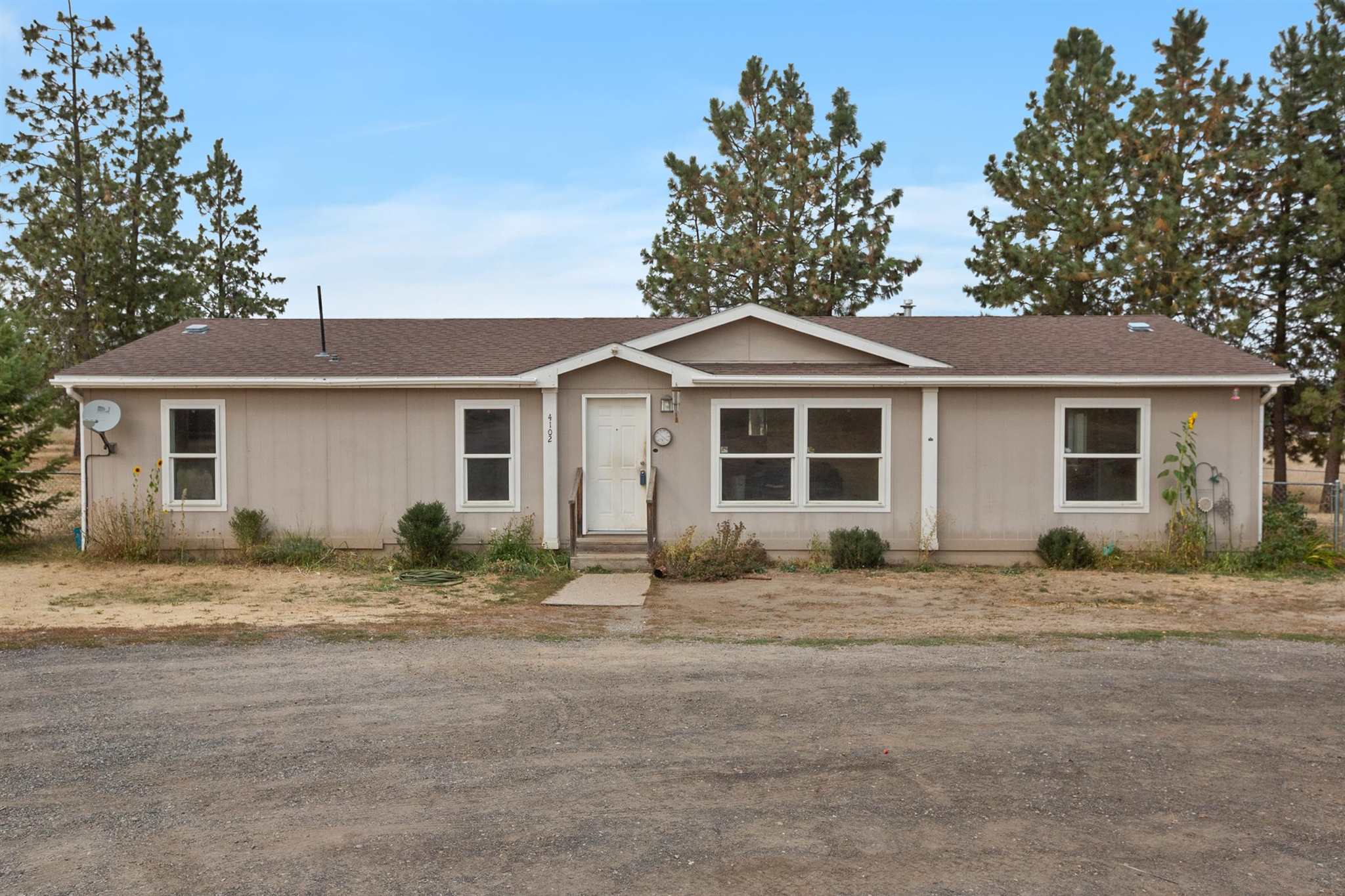 Location Location!!! This home is set back just off of HWY 395 just before the Deer Park Yokes. Featuring 3 bedrooms 2 bathrooms and 2 Livingroom areas. A 30X30 Shop with power and a loft. Come make this home yours. New paint and new flooring will revitalize the home and make it feel like your own. *Ask me how you can save 1% off of closing costs with your offer**